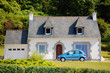 Typical country cottage house and car, Brittany, France.