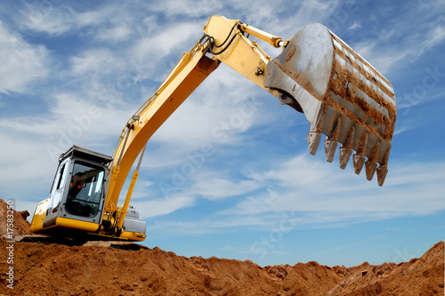 canvas print picture Excavator loader in sandpit