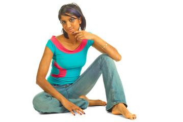 Beautiful brown woman sitting on the floor