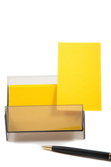 Yellow business card in a box with empty space for text.