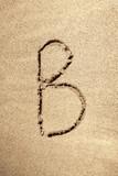 Alphabet letter B handwritten in sand poster