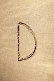 Alphabet letter D handwritten in sand poster