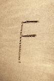 Alphabet letter F handwritten in sand poster