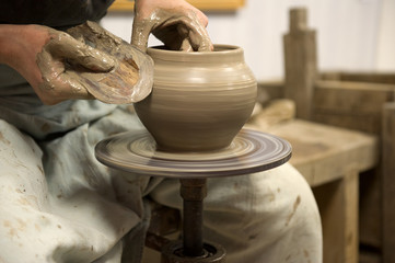 Artisan working on a potter's wheel