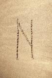 Alphabet letter N handwritten in sand poster
