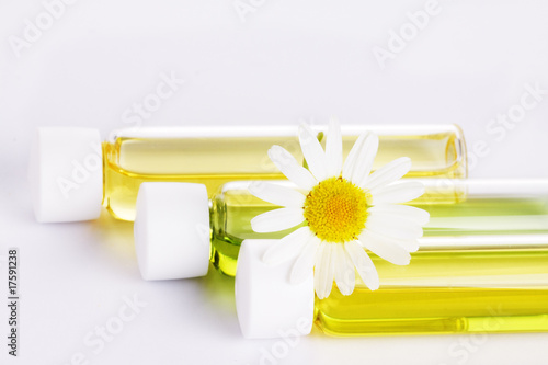 Aromatic organic oil with chamomile flowers
