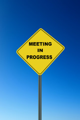 Caution Sign for Meeting in Progress