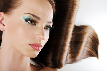 Beauty female face with  brown long healthy hair