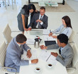 High angle of business people working in a meeting