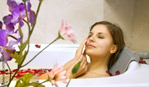 woman in a bath with rose-petals