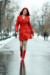 Full length, walking woman  red winter jacket