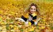 Beautiful smiling woman in autumn park. Shallow DOF.