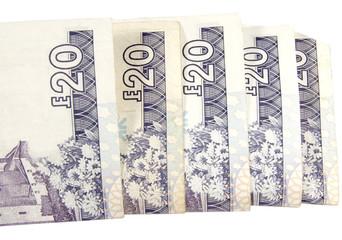 scottish twenty pound notes isolated on white background