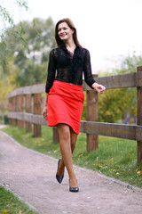 Full length, walking woman  red skirt
