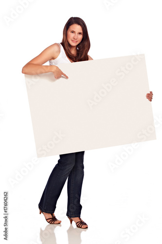 Beautiful woman point at white board in her hand