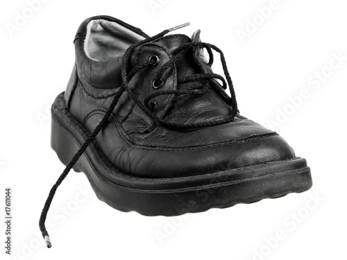 Leather boot with the untied lace, isolated on white background