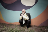 Unemployed businessman pondering poster