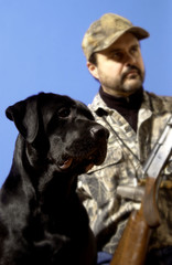 Man out hunting with his dog
