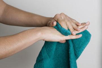 Drying hands with a towel