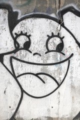 Smiling face, urban graffiti background