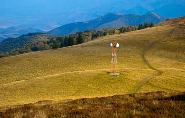 Telecommunication antenna on mountain meadow