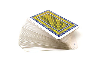 Pack of playing cards with a dark blue and yellow shirt