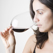 Pretty young woman tasting red wine