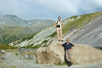 two mans near a huge stone