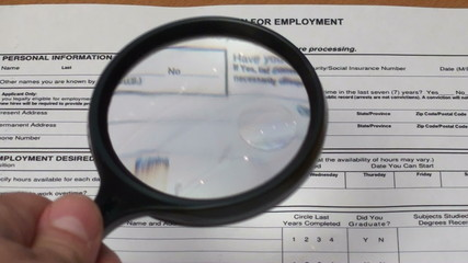 Scrutinizing job application form - HD