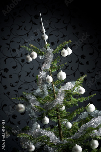 Silver decorated Christmas tree with balls and chains