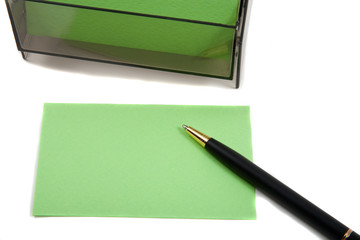 Green Business (blank) card on White with pen