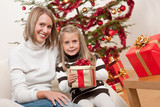 Happy blond woman with child on Christmas