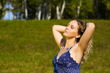 Young woman relaxing on nature.
