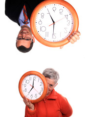 mature woman and businessman with clock