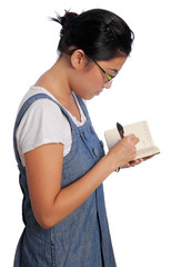 Girl writes in her notebook