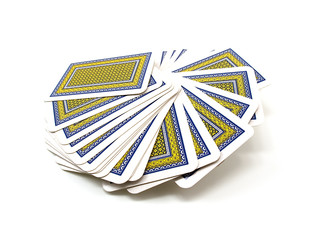 Full pack of playing cards with a dark blue and yellow shirt