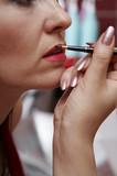 Close up of beautician creating makeup poster
