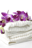 Close up spa towel with pink orchid,