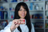 pharmacist holding a pill