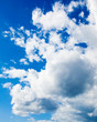 white cumulus clouds in the blue sky. Background