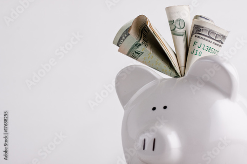 One stuffed, overfilled full piggy bank - 17688255