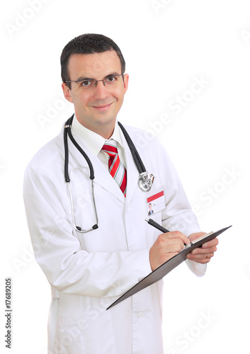 Young medical doctor write on paper pad. Isolated