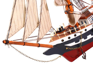 Model of sailing frigate. Isolated.Fragment