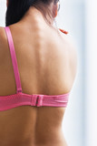 Woman back with one bra strap for breast cancer cause poster