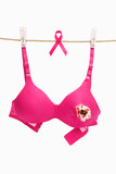 Broken pink bra with ribbon for breast cancer concept poster