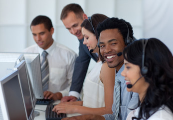 Manager talking to his business team in a call center