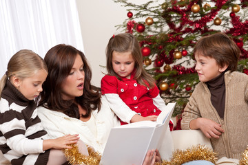 Happy family: mother with three children on Christmas