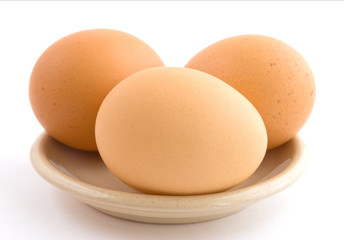 Three chicken eggs.