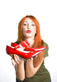 woman with the  red varnished shoes poster