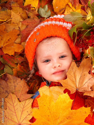 Girl in autumn orange  leaf and red berry. Outdoor.